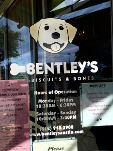 The glass door to the dog boutique and bakery features a caricature of Bentley, the yellow Labrador retriever that inspired Michelle Taylor to open her store.